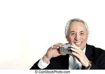 senior with camera