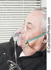 oxygen mask on senior