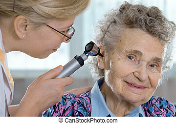 Senior woman being examined by the