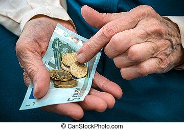 Senior woman counting money