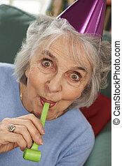 Senior Woman Enjoying Party Celebrations