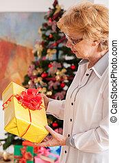 Senior woman holding Christmas gift