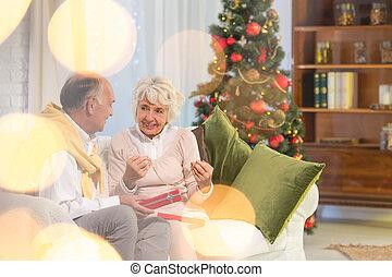 Senior woman holding christmas present
