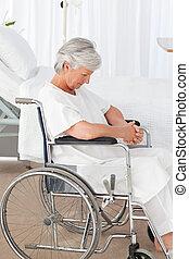 Senior woman in her wheelchair