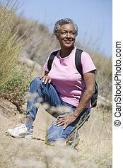 Senior woman on a walking trail
