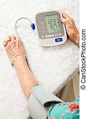 Senior Woman Taking Blood Pressure