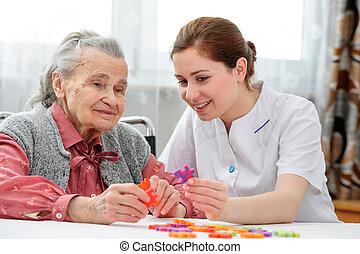 Senior woman with her elder care nurse