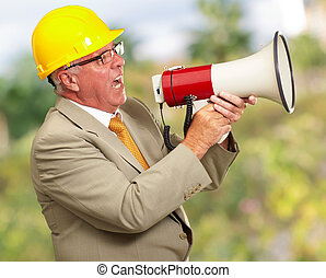 Senior Worker Shouting With Megaphone