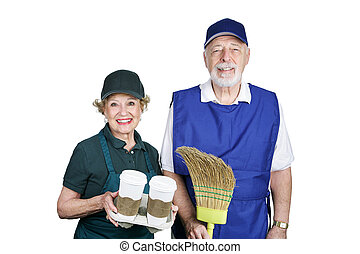 A senior couple going back to work in the service industry. Isolated on white.