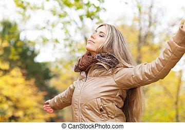 Serene autumn woman
