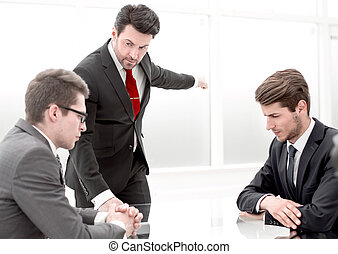 serious boss dismisses an employee for poor performance
