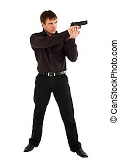 serious man with a gun standing against isolated white background