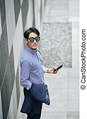 Serious man with smartphone