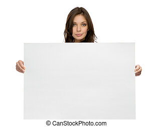 Half-length portrait of serious woman keeping copyspace, isolated on white