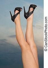 legs against the sunset sky