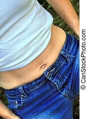 showing off a slim tummy