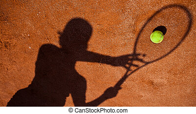 shadow of a tennis player in action on a tennis court