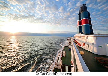 Ship deck, board view, ocean at sunset