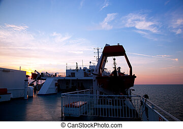 Ship deck view, ocean at sunset