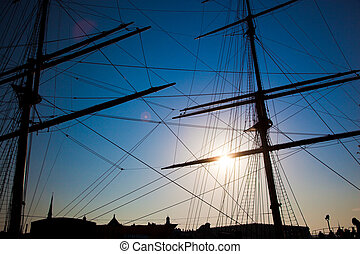 Ship sails silhouette at sunset