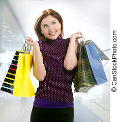 Shopper smiling woman shopping happy on the city