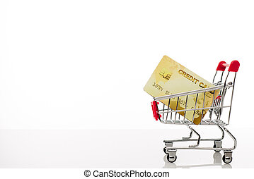 Shopping cart with credit card and copy space on white background