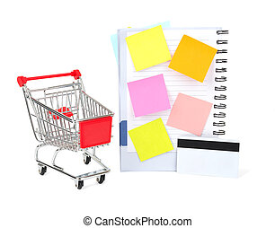 Shopping cart with credit card and copybook