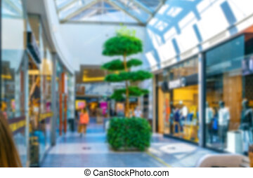 Shopping supermarket blurred background. Interior of retail centre store in soft focus. People shopping in modern commercial mall center. Fashion market hall.