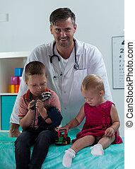Siblings at pediatrician's office