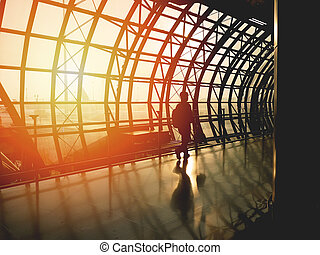 Silhouette people walking on the path in the evening at Suvarnabhumi Airport, Thailand.