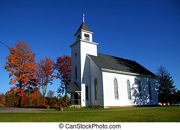 Small historic church in Pennsylvania against blue sky background