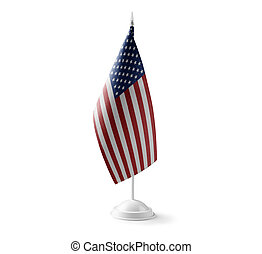 Small national flag of the United States on a white background