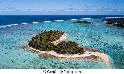 small Rarotonga islands in a small blue lagoon