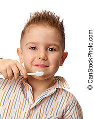smiley boy cleans a teeth