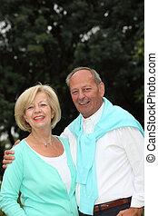 Smiling affectionate senior couple