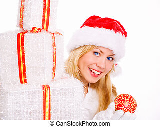 smiling blond woman in christmas clothes with presents holding glass ball