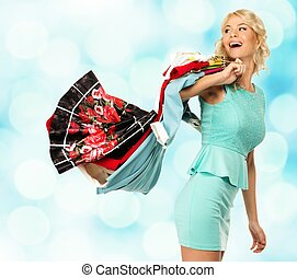 Smiling blond woman with different clothes over blurred background