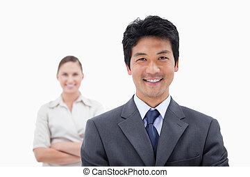 Smiling business people posing