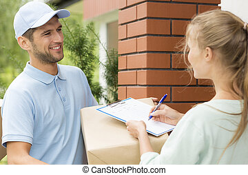 Smiling courier with a parcel