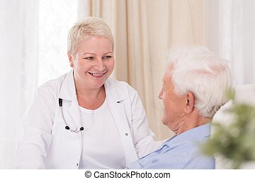 Smiling doctor visiting her patient
