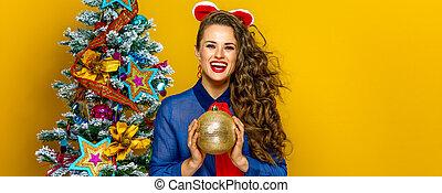 smiling elegant woman holding Christmas ball