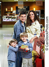 Smiling family in shop