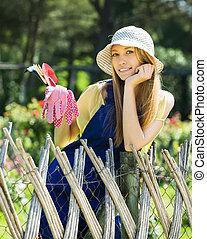 Smiling female gardener in uniform