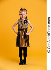 Smiling girl child standing isolated
