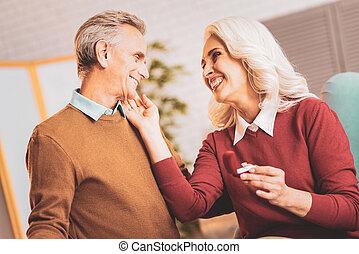 Smiling happy wife hugging her loving husband