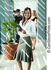 indian businesswoman holding tablet computer