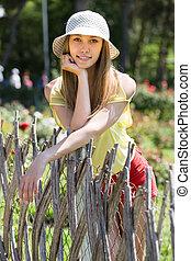 woman near fence