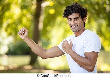 smiling man in martial-arts combat pose