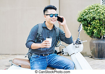 Smiling man with cup of cofee