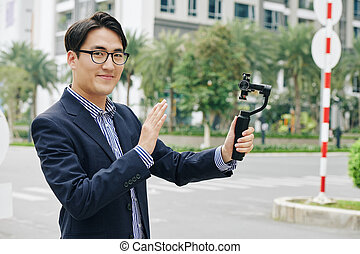 Smiling man with monopod